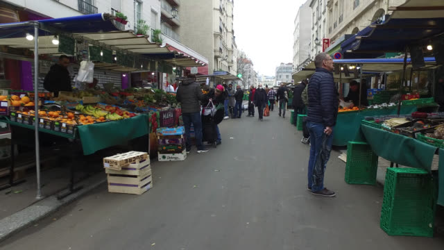 aligre market open, with much less merchant and customer during the second day of confinement in france. people wear protective masks. march 18, 2020... - french culture stock videos & royalty-free footage