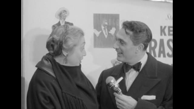 CU Aline MacMahon being interviewed by Robert Alda outside the Paramount Theater at the premiere of The Eddie Cantor Story