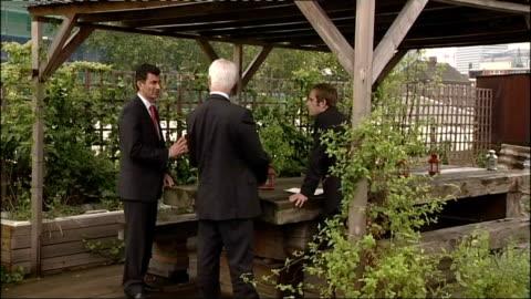 alistair darling visits young entrepreneurs; england: london: ext alistair darling mp meeting 'increation' representative and prince's trust... - プリンスズトラスト点の映像素材/bロール