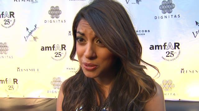 Aliya Jasmine on being here on supporting amfAR on the highlight of TIFF so far at the amfAR And Dignitas International Partner On 'Cinema Against...