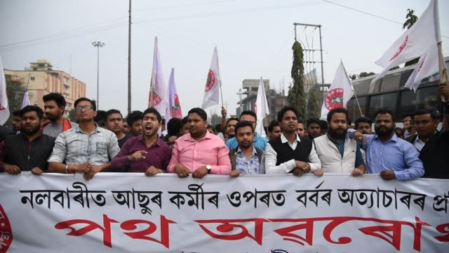 All Assam Students' Union activists block National Highway 37 near Basistha during a protest against the recent attack on AASU members at Ghagrapar...