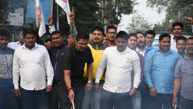 All Assam Students Union activists burns effigy of BJP Assam state president Ranjit Das and Assam Chief minister Sarbananda Sonowal protesting...