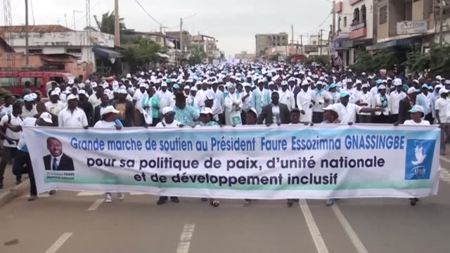 All dressed in white T shirts bearing the image of Togolese President Faure Gnassingbe several thousand activists of the ruling Union for the...