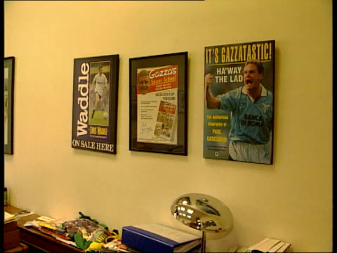 All eyes on Paul Gascoigne as England prepare for World Cup ITN Mel Stein sitting at desk working ZOOM IN picture of Gascoigne on wall Framed...