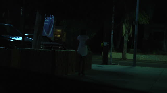 all faces have been blurred clean various night shots from a vehicle driving around los angeles with an anonymous police officer checking on the... - trafficking stock videos and b-roll footage