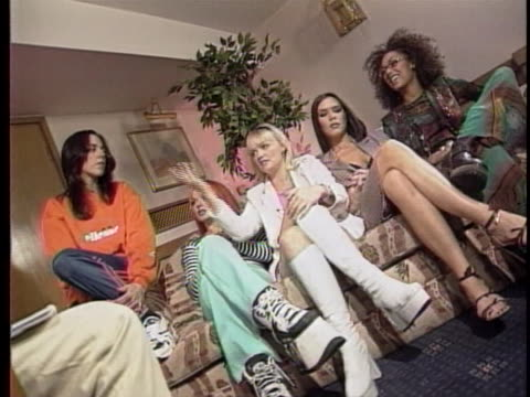 all five spice girls sit on a couch and discuss individuality and their recent success - music or celebrities or fashion or film industry or film premiere or youth culture or novelty item or vacations bildbanksvideor och videomaterial från bakom kulisserna