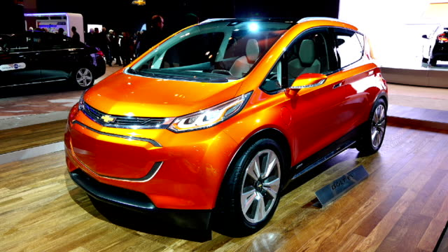 all new 2016 chevrolet bolt ev in the canadian international autoshow which is canada's largest automotive show held annually at the metro toronto... - strategia di vendita video stock e b–roll