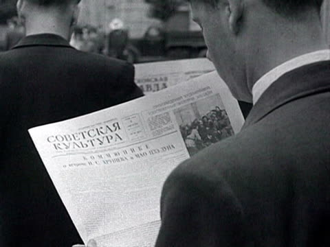 vídeos de stock, filmes e b-roll de ms all over country in bus in car militant readign newspaper relating khrushchev's visit to beijing audio / moscow russia - 1958