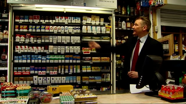 All shop cigarette displays to be banned by 2015 ENGLAND London EXT Dr Alex Bobak interview SOT Packets of cigarettes on shelves in tobacconist's...