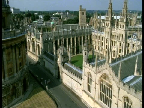all souls college, oxford - ms high angle view, old buildings with spires, radcliffe camera - oxford university stock videos & royalty-free footage