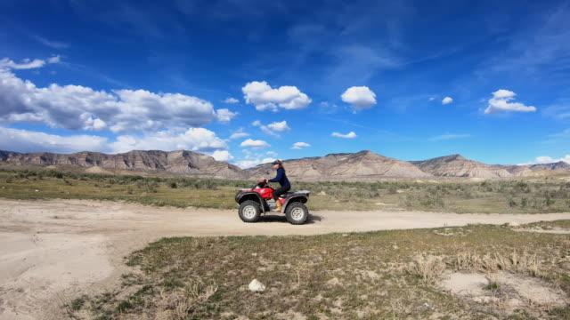 all terrain vehicle, atv, quadbike, desert - quadbike stock videos & royalty-free footage