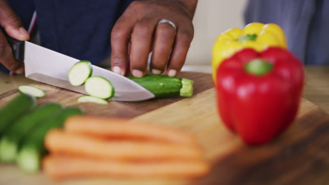all the slicing and dicing is what makes cooking fun - chopping stock videos & royalty-free footage