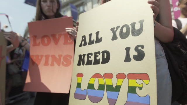 all you need is love sign at pride in london parade 2018 - atmosphere on july 07, 2018 in london, england. - homosexual stock videos & royalty-free footage