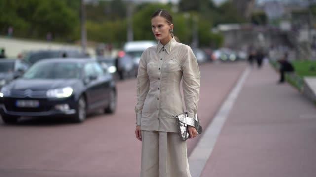 alla kostromichova wears a beige jacket beige flare pants outside hermes during paris fashion week womenswear spring/summer 2018 on october 2 2017 in... - hermes designer label stock videos and b-roll footage
