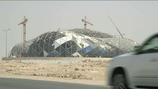 Allegations of corruption over 2022 World Cup spark calls for revote QATAR Doha EXT Doha skyline on horizon Sea TILT UP skyscrapers Skyscrapers...