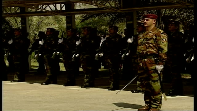 iraqi flag flying blair and al maliki reviewing iraqi troops soldiers standing to attention blair and al maliki reviewing troops nouri al maliki... - iraq stock videos and b-roll footage