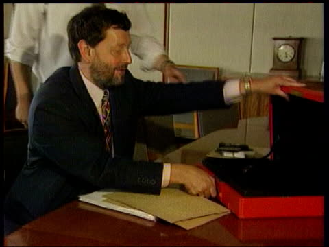 allegations surrounding former lover kimberly quinn; itn lib int blunkett taking documents from red box and reading braille document - assistive technology stock videos & royalty-free footage