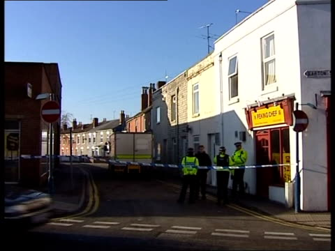 alleged al qaida suspect arrested in gloucester itn gloucestershire gloucester st james street road closed sign tilt up antiterrorist police along bv... - folded stock videos and b-roll footage