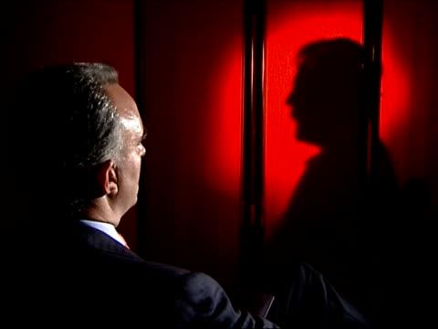 alleged boris berezovsky assassination plot england london mates sat across from boris v former sat with profile seen behind screen interview sot... - 実業家 ボリス・ベレゾフスキー点の映像素材/bロール