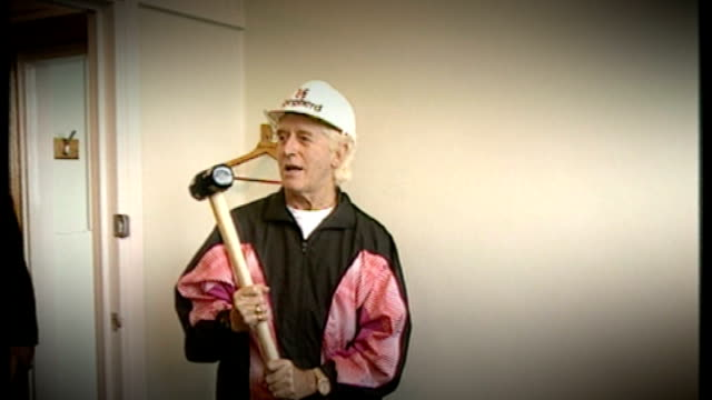 Alleged victims of Sir Jimmy Saville to claim compensation T11101201 Sir Jimmy Saville preparing to hit wall at hospital with sledgehammer Saville...