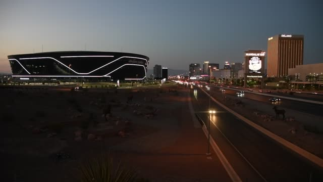 allegiant stadium, the usd 2 billion 000-seat home of the las vegas raiders, is shown west of a marquee at mandalay bay resort and casino and delano... - the strip las vegas stock videos & royalty-free footage