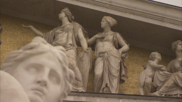Allegorical figures are depicted on the pediment of the Austrian Parliament building.