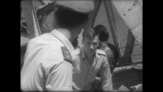 allenby bride on the jordan river / israeli pilots and pows shake hands with soldiers as they cross the bridge / press follow pilots as they walk... - sechstagekrieg stock-videos und b-roll-filmmaterial