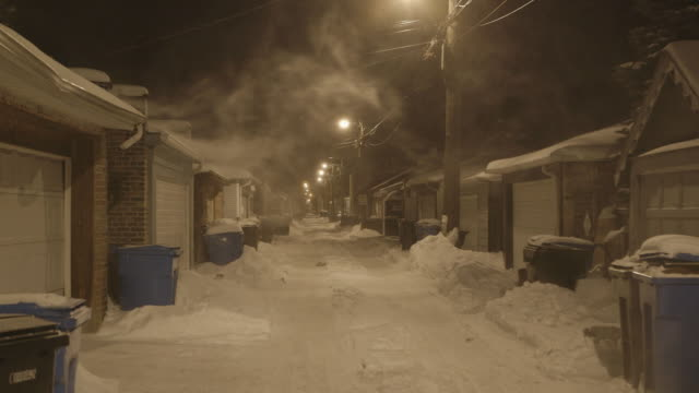 ws alley at night during blizzard - illinois stock-videos und b-roll-filmmaterial