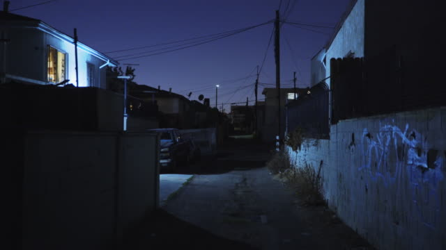 alley behind apartments - night - stationary stock videos & royalty-free footage
