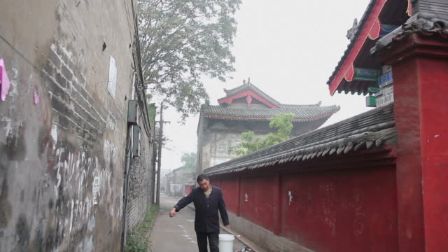 ws alley beside templeon  in moring/hancheng,shaanxi,china - only mature men stock videos & royalty-free footage