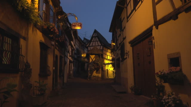 alley with half-timbered house in a picturesque village at night - timber stock videos & royalty-free footage