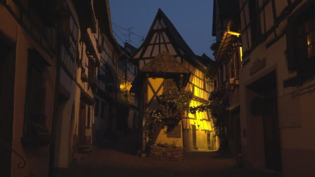 Alley with half-timbered house in a picturesque village at night