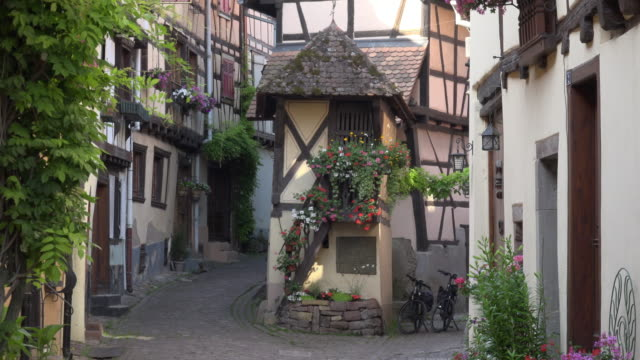alley with half-timbered house in a picturesque village - facade stock videos & royalty-free footage