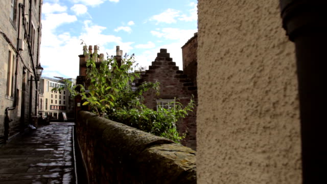 alleyway  with a second shot of rooftops and chimneys - 19th century style stock videos & royalty-free footage