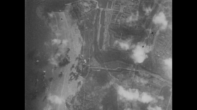 vidéos et rushes de allied b-24 liberator and b-26 marauder bombers target german occupied positions in france before the d-day landings in june 1944. - terrorisme