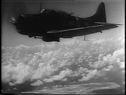 Allied bomber planes in air / view of bomber plane wing with Pacific Ocean below / gunner camera view of bomber plane shooting at airfield on ground...
