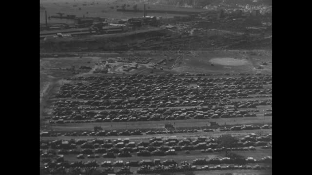 stockvideo's en b-roll-footage met ws allied fleet in naples harbor / ws mt vesuvius / aerial shot of equipment and supplies assembled for invasion / overhead view of trucks assembled... - militaire invasie