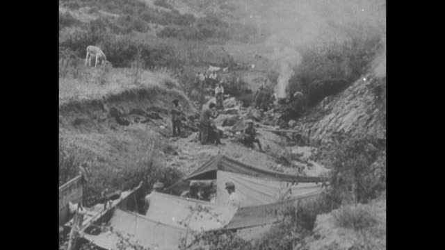 stockvideo's en b-roll-footage met ls allied forces camp in valley of serbian mountain range during world war i / note film has nitrate deterioration [exact year not known] - joegoslavië