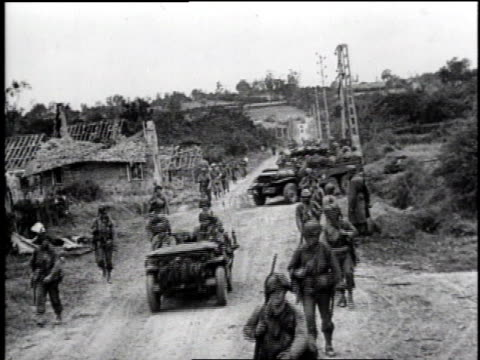 ws allied jeeps driving by as soldiers walk along road near camp / ms trucks driving down road - la manche stock videos and b-roll footage