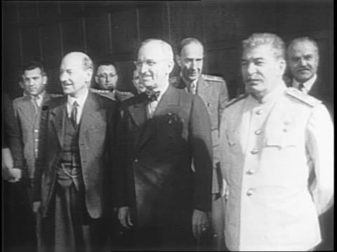 allied leaders seated around a table in a meeting / joseph stalin standing, placing papers on the table / harry s truman shaking hands with clement... - potsdam brandenburg stock videos & royalty-free footage