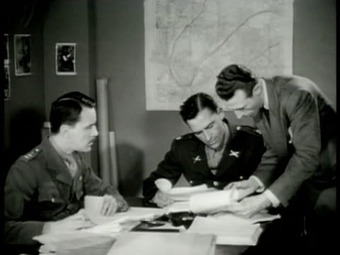 Allied Military Intelligence office w/ officers looking over paperwork CU European Resource Requisition list from Germany Intelligence officers...