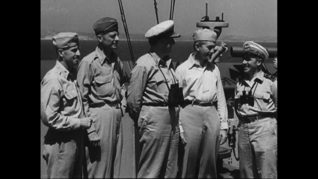 allied officers on deck of ship posing for photo opportunity, from left to right us general gordon saville, us general alexander patch, us admiral... - royal navy stock videos & royalty-free footage
