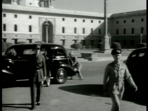 Allied officers walking up steps Sentry saluting ABDA CommanderinChief General Sir Archibald Wavell getting out of car walking into building in...