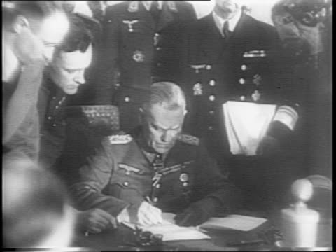 allied officials meet in berlin / general wilhelm keitel and gregory zhukov sign surrender papers / german uboats off coasts / u858 surrenders off... - arrendersi video stock e b–roll