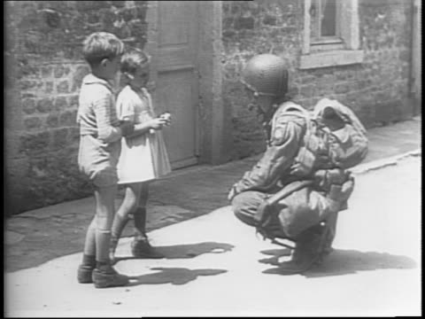 allied paratroopers set off explosion miles ahead of infantry during d-day invasion / us soldiers in field and crouching behind tree / soldiers speak... - normandy stock videos & royalty-free footage