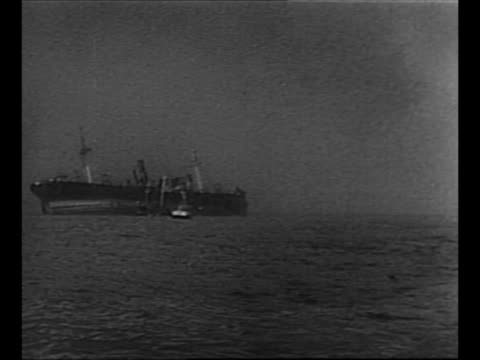 allied planes fly inland to cover evacuation of dunkirk during world war ii / ws smaller boat stands near larger ship / soldiers help another soldier... - militärschiff stock-videos und b-roll-filmmaterial