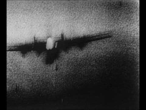 allied planes in sky during wwii air battle / bombs fall away / luftwaffe plane flies / plane approaches firing as bombs drop / aerial smoke from... - luftwaffe stock videos and b-roll footage