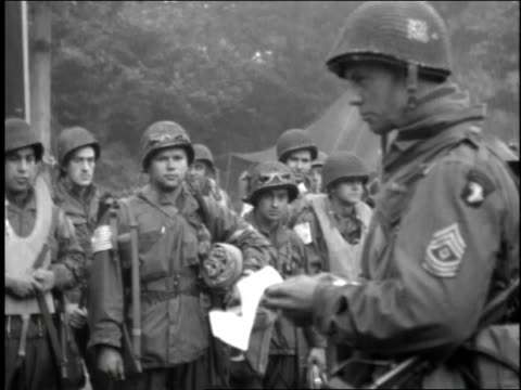 allied soldier in wwii reads from a piece of paper to an assembled crowd of fellow soldiers - 1944 stock videos and b-roll footage