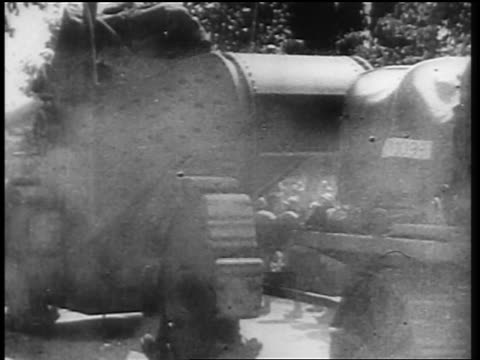 vídeos de stock e filmes b-roll de allied soldier towing tank into germany after world war i / newsreel - 1919