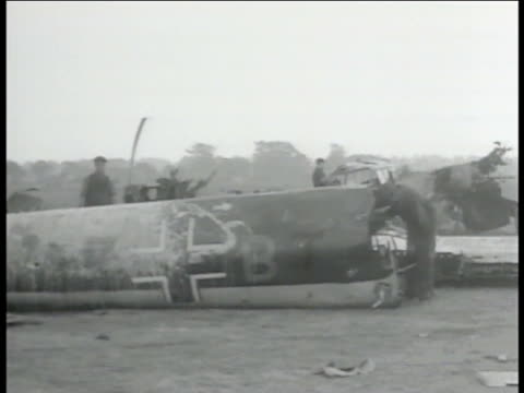 allied soldiers going through body of wrecked german aircraft. tail of wrecked nazi aircraft w/ swastika insignia. - nazi swastika stock videos & royalty-free footage